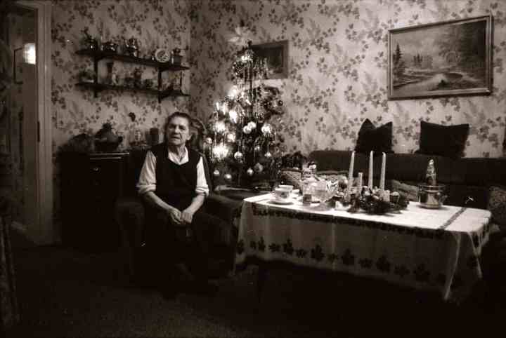 One of the random joys of travel. An 82 year-old shows us her living room, decorated for Christmas in Hamburg, 1984.. There is a Xmas tree with lights in the corner, and candles on the table.