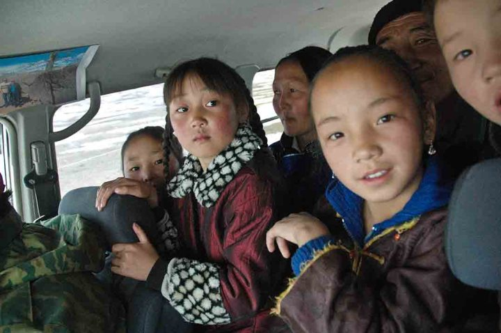 Mongolia - the 'Delgerengui Schoolbus'. The back seat of our Landcruiser taking a bunch of kids, and some parents, to school.