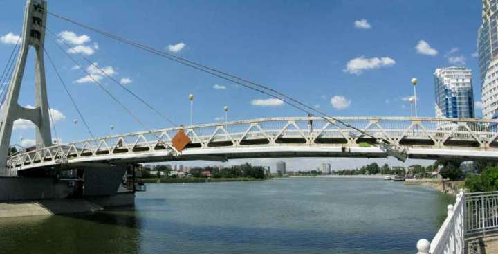 The Bridge of Kisses in Krasnodar, Russia. That's Adygea on the other side of the Kuban River.