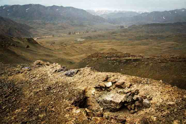 Foxholes in which ten Mongolian soldiers fought to the death, line a ridge in the far southwest of Mongolia. They fought against an overwhelming force who attacked from China (in the background of this image).