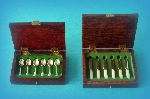 Miniature silver - boxes containing teaspoons & teaknives