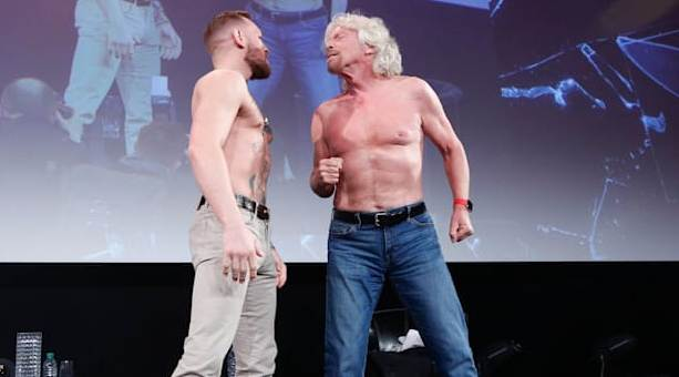 Conor McGregor wins award. Goes shirtless with Richard Branson