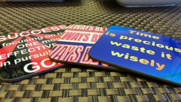buy a pack of coaster with inspirational quotes printed on them