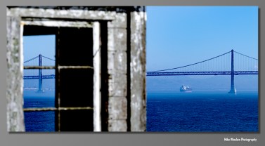 The San Francisco Bay Bridge photographed from Alcatraz. Interesting shot because the focus is on the bridge tower in the window.