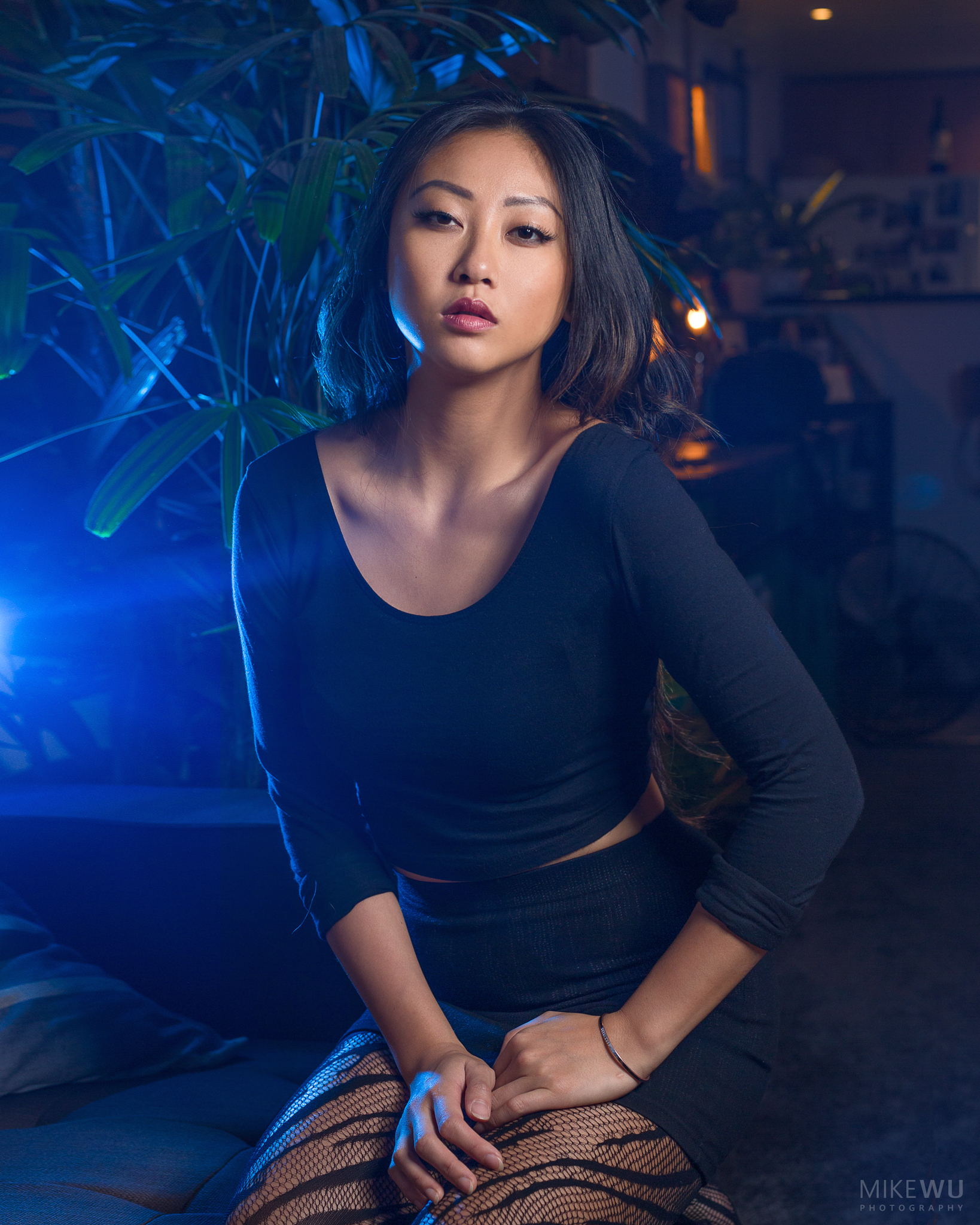 vancouver portrait photographer mike wu indoor studio photography beauty ophelia couch plant sitting night unique gel blue flare style