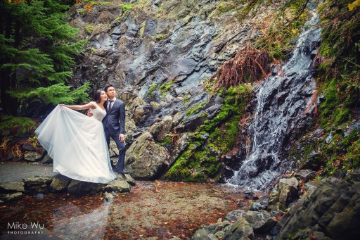queen elizabeth park, couple, wedding, waterfall, water, reflection, nature, natural, engagement, photography, portrait, environmental, natural, nature, love, couple, loving, embrace, dress, asian