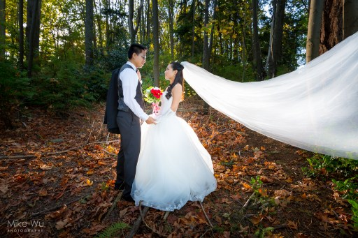 wedding, couple, vancouver, stanley park, off camera flash, love, stare, veil, forest, trees, leaves, autumn, fall, nature, environment, portrait, love, bouquet, natural, leaves, flash, quiet