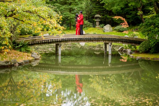vancouver, engagement, garden, bridge, water, reflection, red, chinese, asian, japanese, beautiful, serene, green, leaves, wedding, couple, love, hug, embrace, together, traditional