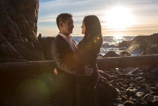 wedding, movie-like, vancouver wedding photographer, lighthouse park, sunset, atmosphere, embrace, engagement session, waves, splash, rocks, log, vancouver, bc