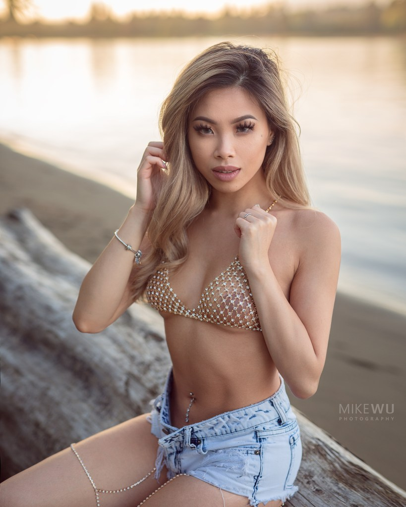 vancouver portrait photographer mike wu outdoor boudoir session asian jenny log beach golden hour sunset water waves shore sand lingerie jean shorts chains jewerly beauty