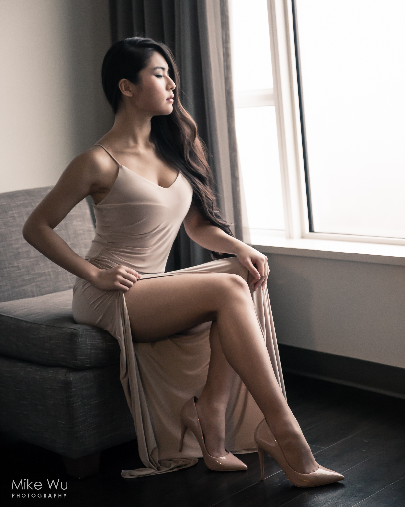 vancouver portrait photographer mike wu photography studio indoor asian chinese couch window beauty sitting heels dress makeup hairstyle natural