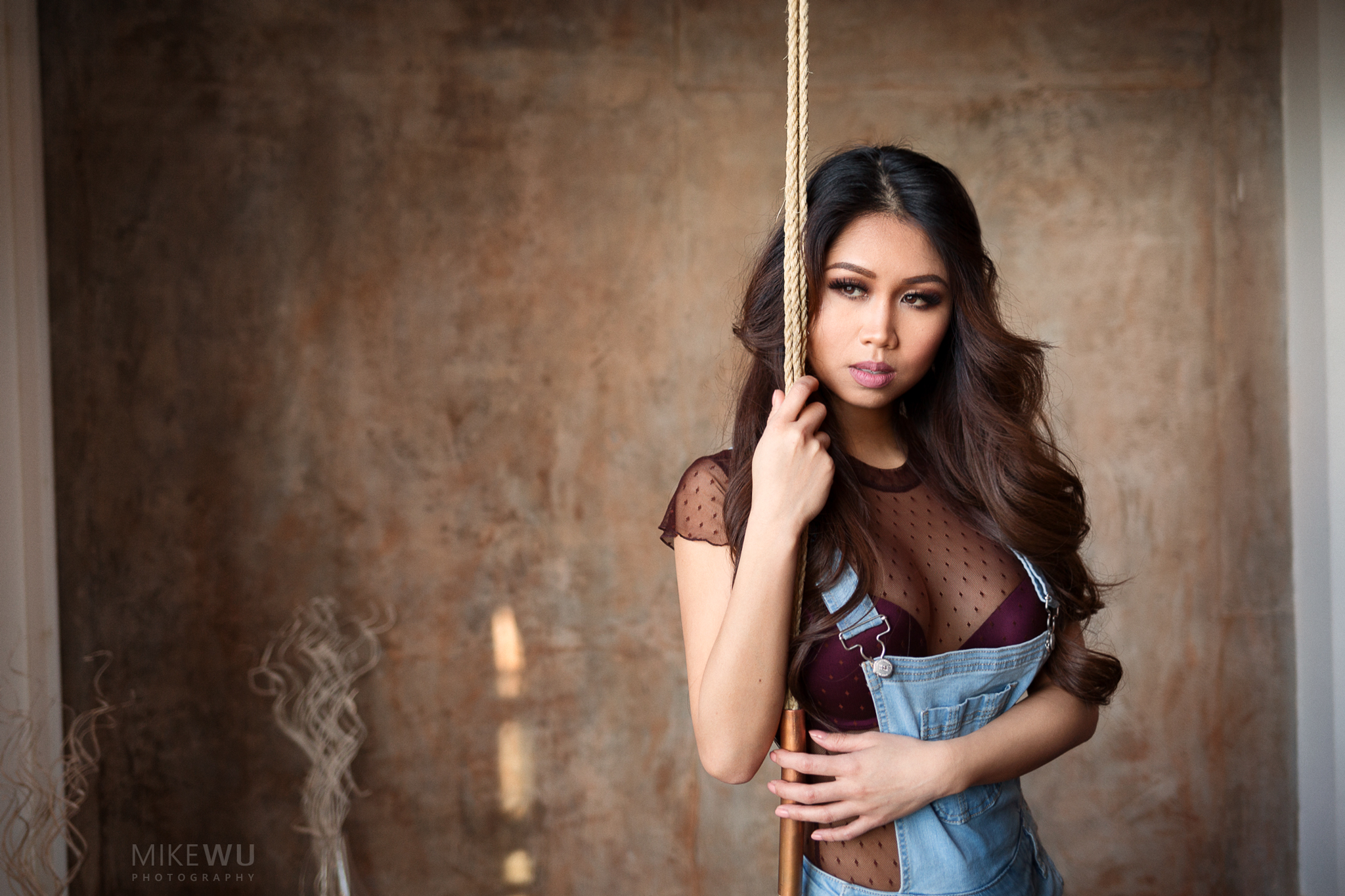 vancouver portrait photographer mike wu indoor studio photography rope inside overalls beauty asian chinese female lady classy concrete wall golden