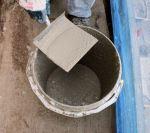 Wet lime mortar on harling trowel