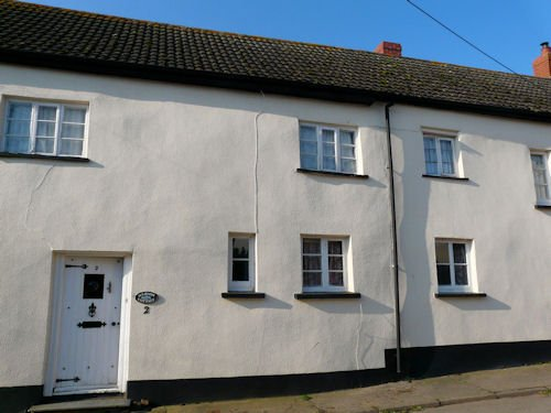 Devon cob cottage with cement render & modern masonry paint