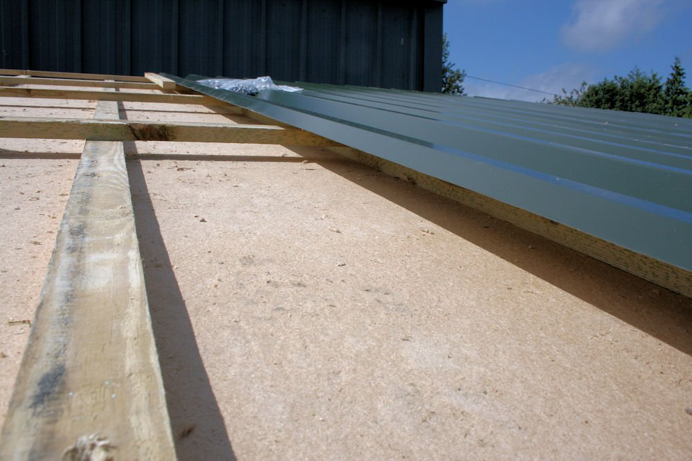 Cross battening to allow an air gap is fixed and the roof to match the original screwed down.