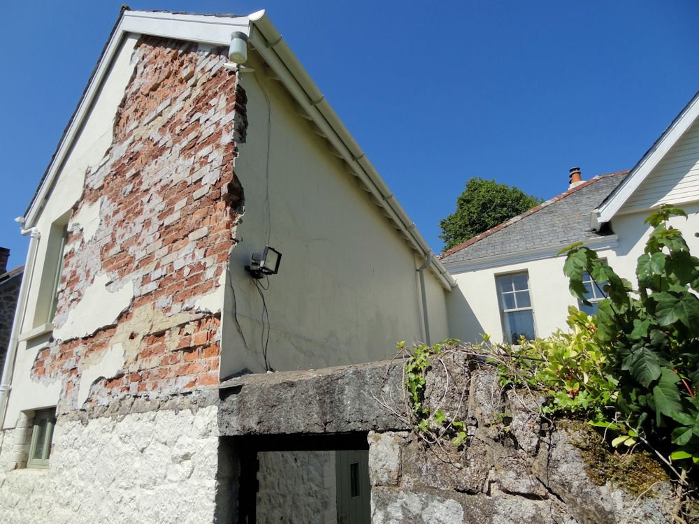 Hard cement render removal can result in damage to the soft masonry