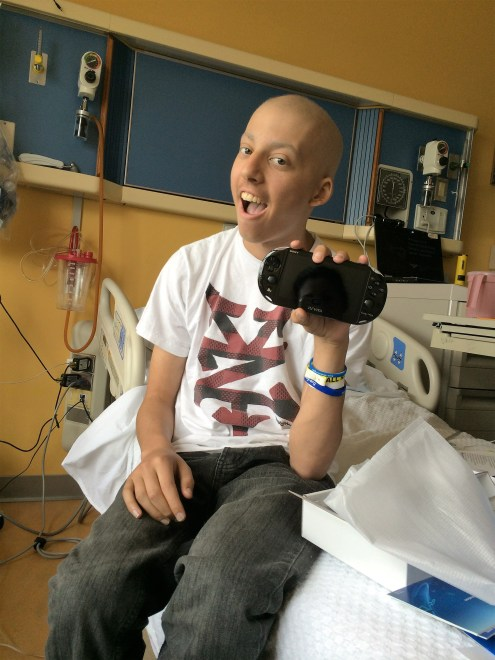 pediatric cancer patient with gaming system to help cope with cancer