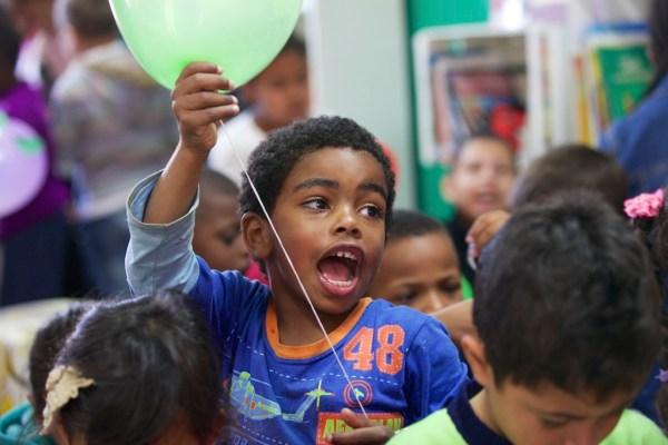 A boy holding a balloon