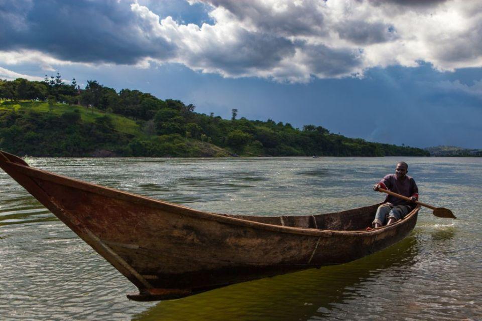 A man paddling a boat on the River Nile in Jinga, Uganda