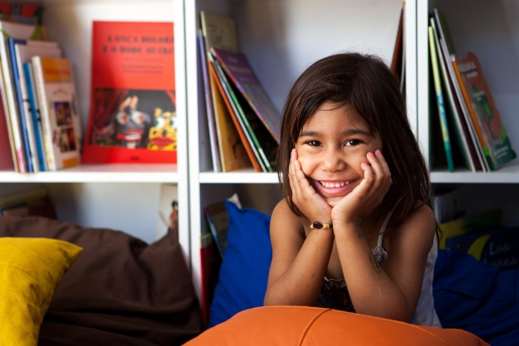 smiling girl in a library