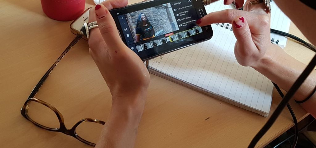 person editing a film on a mobile phone