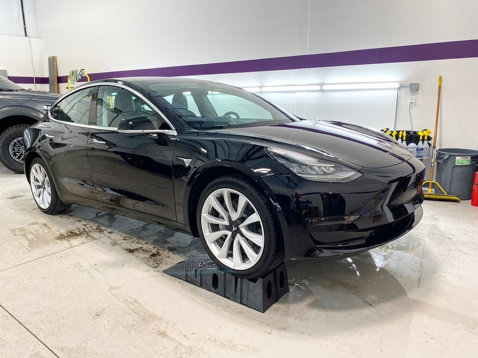 black Tesla clear bra and window tinting work at Mile High Customs