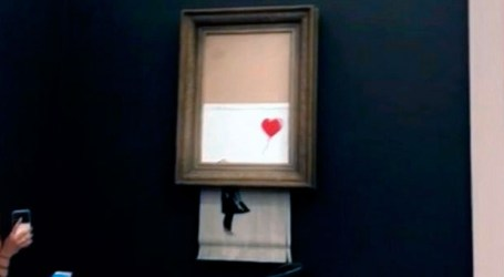 Winning bidder for Banksy painting that self-destructed goes through with purchase