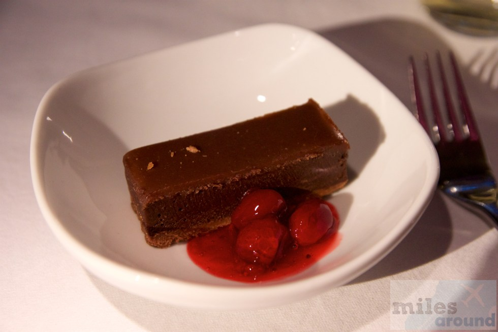 Dark chocolate fondant with hazelnut nougat and cranberry-raspberry compote
