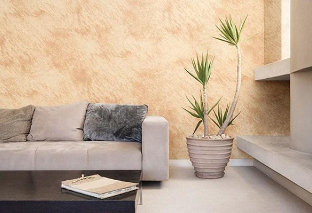 Duvarlarda efektlerle boyanmış modern bir oturma odası