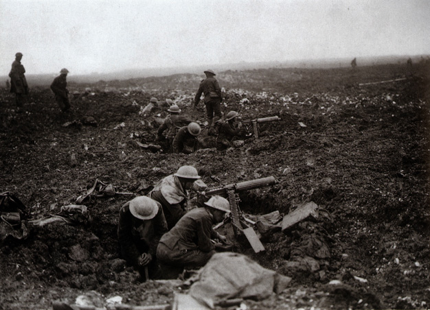 Canadian machine-gunners make use of shell-holes as emplacements.