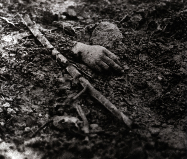 Crouching in muddy trenches and shell-holes brought men into close contact with the dead. The whole battlefield was strewn with human remains.