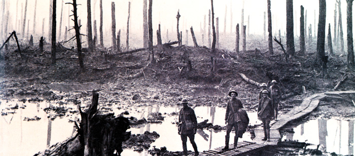 British soldiers cross the waterlogged Passchendaele battlefield.