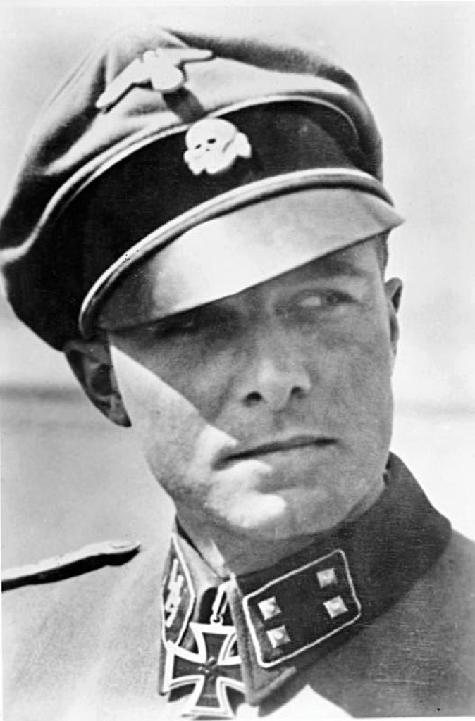 General Joachim Peiper (1915-1976), commander of 1st SS Panzer Regiment, and a Nazi fanatic whose men murdered several hundred American POWs in the Ardennes.