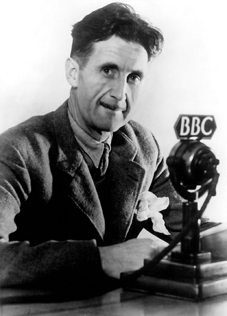 Black and white picture of George Orwell at the BBC.