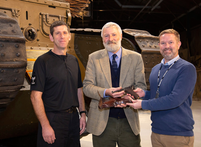 Sergeant Bill Monk (on the left), Specialist Operations, handed  in the discovery to Tank Museum curator David Willey (centre) and Force Armourer Jamie Ross (right). Image: Bovington Tank Museum