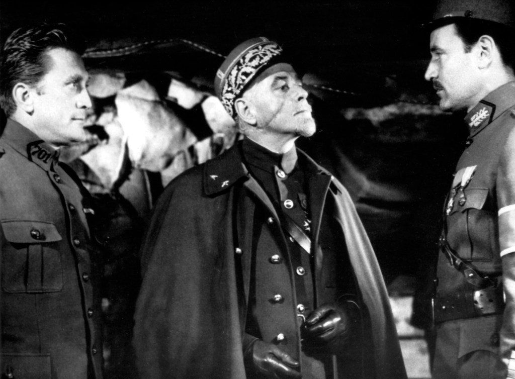 George Macready (centre) as General Mireau. The actor's slight facial scar was accentuated to give him a more sinister appearance.