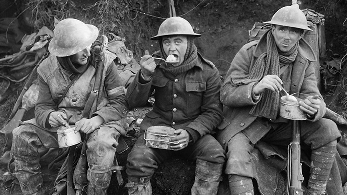 British soldiers eating in the trenches during World War I. Food was extremely difficult to acquire on both sides of the front.