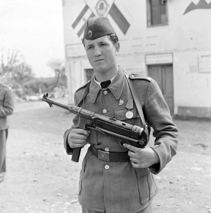 May 1946: Motorpatrolmen Viaho Mianovis wearing official uniform and holding a German postil, working in Trieste area.