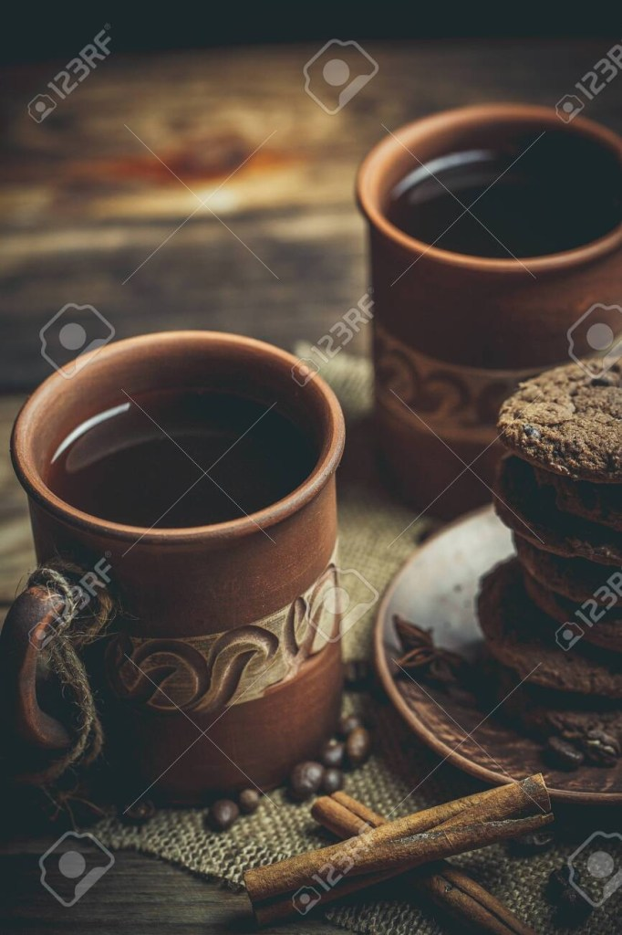 brown clay vintage coffee mugs and delicious chocolate chip cookies