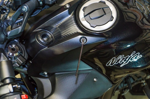 Reinstallation of the ignition cover fairing is just as easy as removing it.