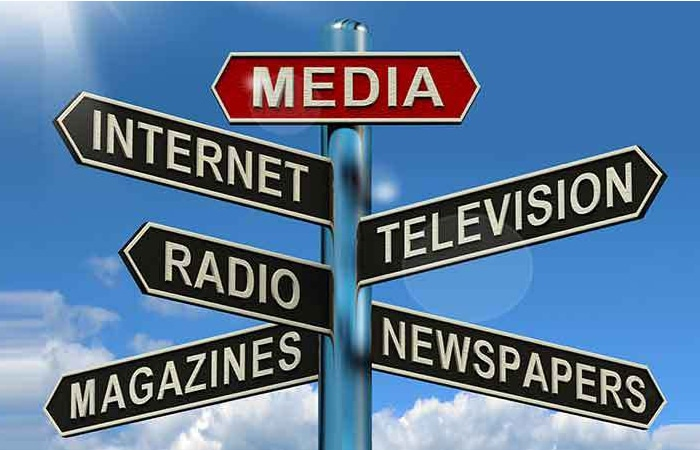 intersecting roads sign with marketing options of media, internet, television, radio, magazines, and newspapers