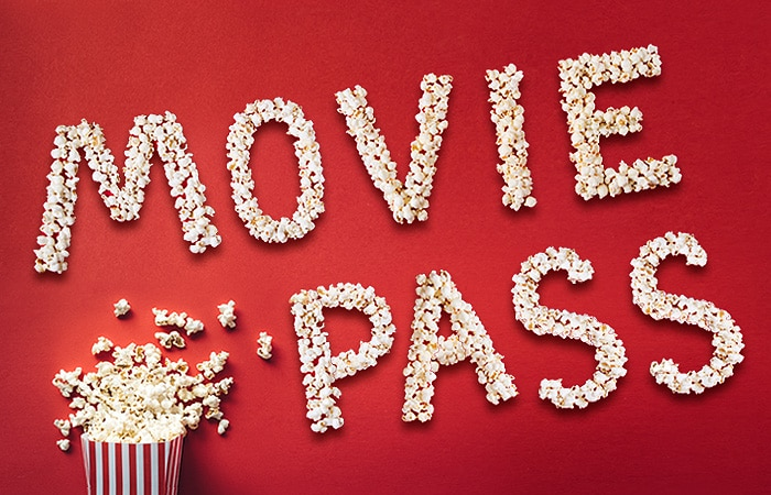 Movie Pass spelled out in popcorn with movie popcorn container spilled over