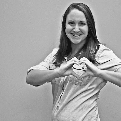 Lacey Guillory with her hands in the shape of a heart