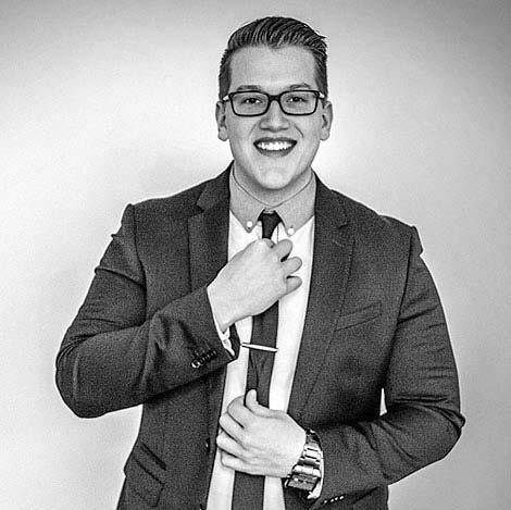 Seth Wilson straightening his tie