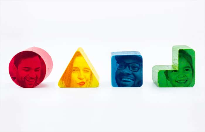 Different types of people faces on different colored blocks