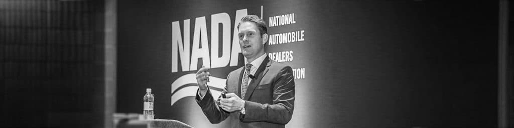 Erik Radle speaking at NADA conference