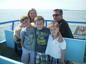 Family aboard the Miller Ferry seated up top with Lake Erie view