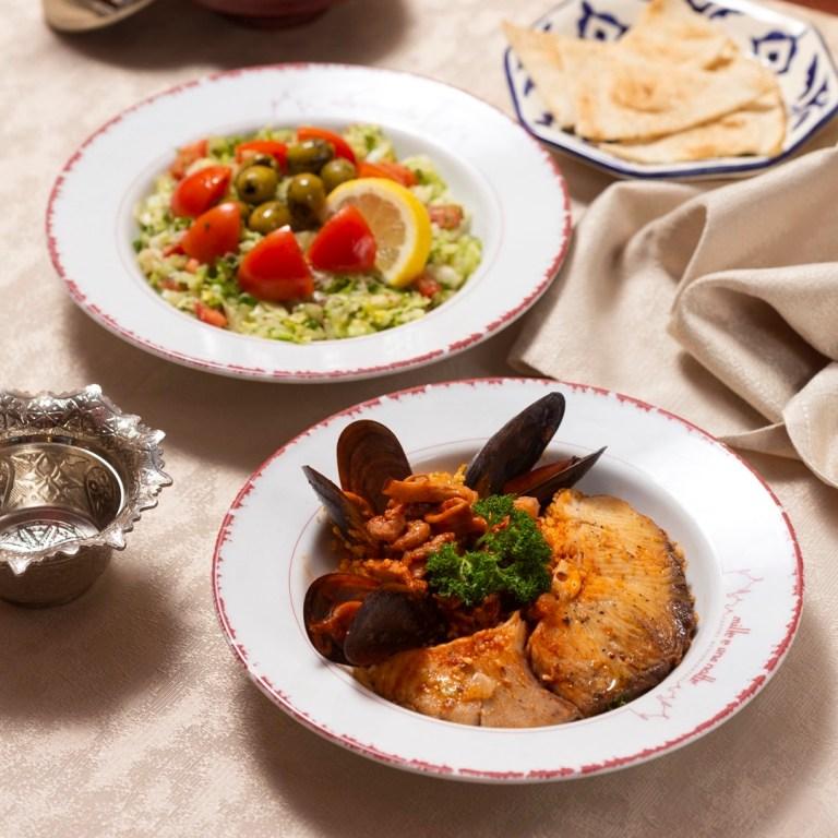 Couscous con pesce e insalata siriana