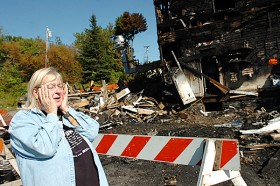 """Valerie Robertson of Milo reacts to the remains of her business, Hobnobber's Pub, on Wednesday, September 17, 2008. A devastating fire, which has been ruled arson, was started in the pub and proceed to quickly spread down Main Street in the early morning hours of Sunday, September 14. Hobnobber's had only been open for three weeks. """"We were having a great time,"""" Robertson said of running the business."""