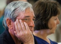 John and Barbara Crossman, owners of Milo True Value Hardware Store, listen as officials discuss the help available for fire victims during a meeting Wednesday morning at the Milo Town Office. The hardware store was leveled by the deliberately set fire which blazed down Milo's Main Street early Sunday morning .